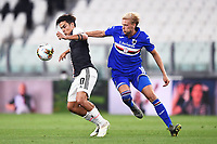 26th July 2020, Turin, Italy;  Paulo Dybala holds off Morten Thorsby  during the Seria A league game, Juventus versus Sampdoria