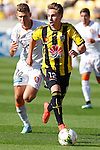 Phoenix's Tyler Boyd, right, looks infield as Brisbane Roar's Daniel Bowles runs in from the left in the A-League football match at Westpac Stadium, Wellington, New Zealand, Sunday, January 04, 2015. Credit: Dean Pemberton