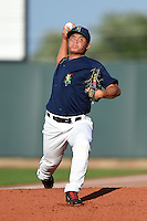 Cedar Rapids Kernels pitcher Chih-Wei Hu (40) delivers a pitch in the bullpen before a game against the Quad Cities River Bandits on August 18, 2014 at Perfect Game Field at Veterans Memorial Stadium in Cedar Rapids, Iowa.  Cedar Rapids defeated Quad Cities 4-2.  (Mike Janes/Four Seam Images)