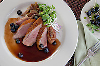 Pan Seared Duck Breast and Duck Confit: truffle potato pur&eacute;e, blueberry-Madeira sauce, micro greens<br /> Waterfront Bistro .Cruz Bay, St. John.U.S. Virgin Islands