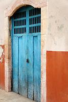 Old wooden door of a house in Santa Elena, Yucatan, Mexico..