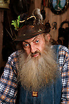 Infamous moonshiner Popcorn Sutton poses for a portrait at his home in Parrotsville, Tenn. Sutton committed suicide about two hours after the photo was taken. (Images By Design Photo/Wade Payne)