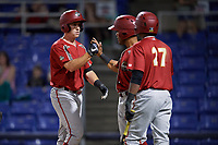 Altoona Curve pinch hitter Jordan Luplow (23) is congratulated by his teammates after hitting a go ahead two run home run in the top of the ninth inning during a game against the Binghamton Rumble Ponies on May 17, 2017 at NYSEG Stadium in Binghamton, New York.  Altoona defeated Binghamton 8-6.  (Mike Janes/Four Seam Images)