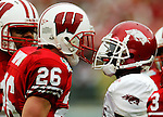 Defensive back Zach Hampton faces off with an Arkansas player after a play gone bad.<br />