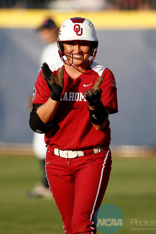 07 JUNE 2016:  Oklahoma outfielder Erin Miller (48) celebrates reaching base during the Division I Women's Softball Championship is held at ASA Hall of Fame Stadium in Oklahoma City, OK.  Shane Bevel/NCAA Photos