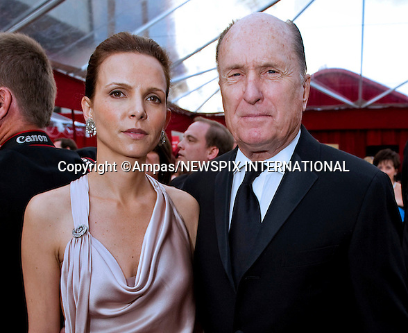 "ROBERT DUVALL AND LUCIANA PEDRAZA.arrives at the 82nd Annual Academy Awards at the Kodak Theatre in Hollywood, CA, on Sunday, March 7, 2010..Mandatory Photo Credit: Newspix International..**ALL FEES PAYABLE TO: ""NEWSPIX INTERNATIONAL""**..PHOTO CREDIT MANDATORY!!: NEWSPIX INTERNATIONAL(Failure to credit will incur a surcharge of 100% of reproduction fees)..IMMEDIATE CONFIRMATION OF USAGE REQUIRED:.Newspix International, 31 Chinnery Hill, Bishop's Stortford, ENGLAND CM23 3PS.Tel:+441279 324672  ; Fax: +441279656877.Mobile:  0777568 1153.e-mail: info@newspixinternational.co.uk"