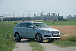 Audi Q7 with Ingolstadt factory in the background.