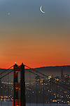Seen from the Marin headlands rising over the north tower of the Golden Gate Bridge was both the crescent moon and the planet Venus pairing up  within minutes of each other during the morning twilight.
