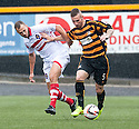 Stirling's Gordon Smith and Alloa's Darryl Meggatt challenge for the ball.