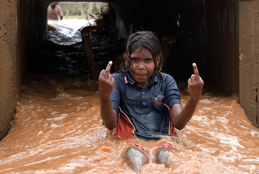 kids take to the drains under the road in Alice Springs when the Todd river flows