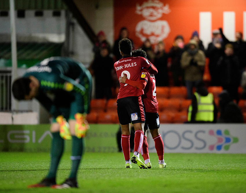 Lincoln City's Liam Bridcutt, right, celebrates scoring his side's equalising goal to make the score 1-1 with team-mate Tyreece John-Jules<br /> <br /> Photographer Chris Vaughan/CameraSport<br /> <br /> The EFL Sky Bet League One - Lincoln City v Milton Keynes Dons - Tuesday 11th February 2020 - LNER Stadium - Lincoln<br /> <br /> World Copyright © 2020 CameraSport. All rights reserved. 43 Linden Ave. Countesthorpe. Leicester. England. LE8 5PG - Tel: +44 (0) 116 277 4147 - admin@camerasport.com - www.camerasport.com