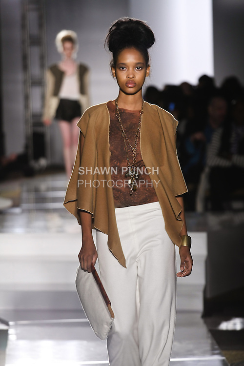 Model walks runway in an outfit by Mia Wright-Ross, for the Parsons 2011 BFA Fashion Show, hosted by Reed Krakoff.