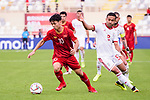 Nguyen Cong Phuong of Vietnam (L) battles for the ball with Omid Ebrahimi Zarandini of Iran (R) during the AFC Asian Cup UAE 2019 Group D match between Vietnam (VIE) and I.R. Iran (IRN) at Al Nahyan Stadium on 12 January 2019 in Abu Dhabi, United Arab Emirates. Photo by Marcio Rodrigo Machado / Power Sport Images
