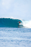 INDONESIA, Mentawai Islands, Kandui Resort, surfer on a wave at Bankvaults