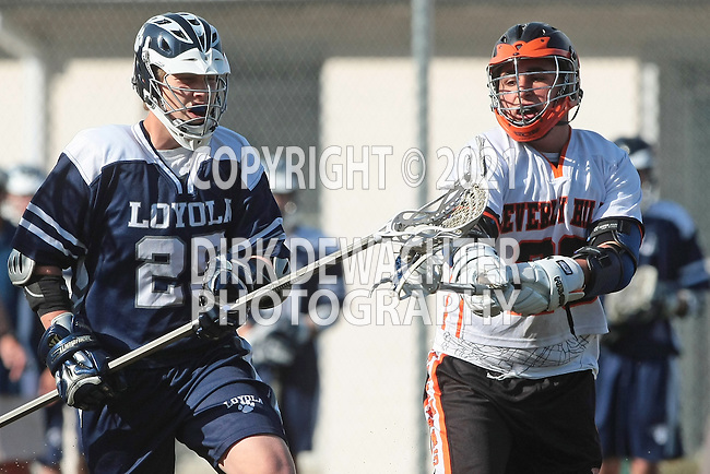 Beverly Hills, CA 04/12/10 - Cooper Perkins (Loyola # 25) and Matin Meh (Beverly Hills # 26) in action during the Loyola-Beverly Hills Boys Junior Varsity Lacrosse game at Beverly Hills High School, Loyola defeated Beverly Hills.