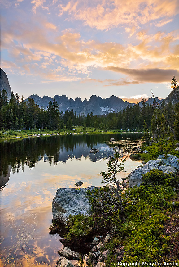 Wind River Range, WY: A colorful sunset and reflections from Horseshoe Lake with Cirque of the Towers in the distance; Lizard Head Meadows; Bridger Wilderness in the Bridger National Forest in summer