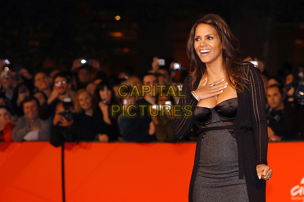 "HALLE BERRY .Red carpet arrivals for the film ""Things We Lost In The Fire"" during the 2nd Annual Rome Film Festival, Rome, Italy, 26th October 2007. .half length black dress pregnant grey tartan plaid strapless cardigan  boobs cleavage hand on chest.CAP/CAV.©Luca Cavallari/Capital Pictures."