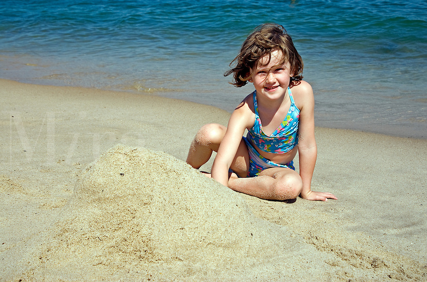 Young girl at the beach playing in the sand, Nauset Beach, Cape Cod, MA