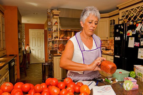 Rosie Wells in her kitchen with fresh tomatos.