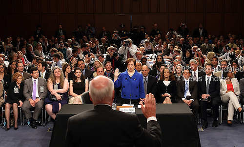 United States Supreme Court nominee Elena Kagan, President Obama's pick to replace retiring Justice John Paul Stevens, is sworn in by U.S. Senate Judiciary Committee Chairman Patrick Leahy (Democrat of Vermont) on the first day of her confirmation hearing before the Senate Judiciary Committee on Capitol Hill in Washington on Monday, June 28, 2010.   .Credit: Win McNamee - Pool via CNP.