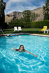 Woman in Swimming pool and mountains of Palm Springs