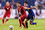 Nguyen Quang Hai of Vietnam (L) fights for the ball with Haraguchi Genki of Japan (R) during the AFC Asian Cup UAE 2019 Quarter Finals match between Vietnam (VIE) and Japan (JPN) at Al Maktoum Stadium on 24 January 2018 in Dubai, United Arab Emirates. Photo by Marcio Rodrigo Machado / Power Sport Images