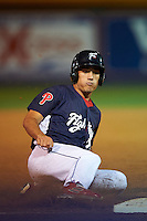 Reading Fightin Phils outfielder Cam Perkins (27) slides into third during a game against the New Britain Rock Cats on August 7, 2015 at FirstEnergy Stadium in Reading, Pennsylvania.  Reading defeated New Britain 4-3 in ten innings.  (Mike Janes/Four Seam Images)