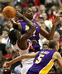 04/08/11--Trailblazers' forward Gerald Wallace  is fouled by Lakers' Andrew Bynum in Portland's 93-86 win over L.A. at the Rose Garden..Photo by Jaime Valdez........................................