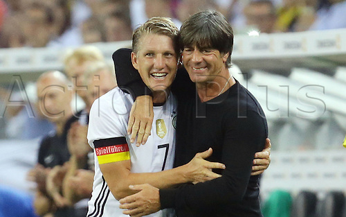 31.08.2016 Moenchengladbach, Germany. International football freindly. Germany versus Finland. Bastian Schweinsteiger leaves the field of play and is greeted by Joachim LOEW (team manager)