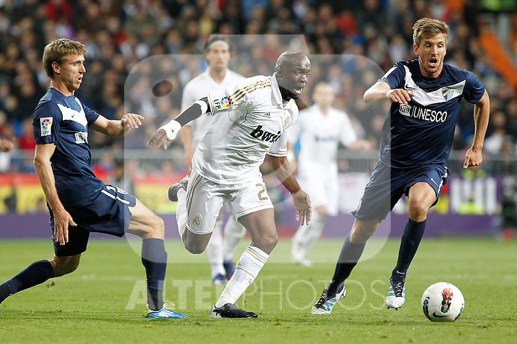 Real Madrid's Lassana Diarra and Malaga's Monreal during la Liga match on march 18th 2012...Photo: Alex Cid-Fuentes / ALFAQUI