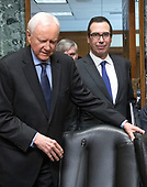 United States Secretary of the Treasury Steven Mnuchin, right, and US Senator Orrin Hatch (Republican of Utah), left, arrive prior to Mnuchin giving testimony before the United States Senate Committee on Finance on the President's Fiscal Year 2019 budget on Capitol Hill in Washington, DC on Wednesday, February 14, 2018.<br /> Credit: Ron Sachs / CNP