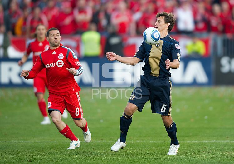 15 April 2010: Toronto FC midfielder Dan Gargan #8 and Philadelphia Union midfielder Stefani Miglioranzi #6 in action during a game between the Philadelphia Union and Toronto FC at BMO Field in Toronto..Toronto FC won 2-1..Photo by Nick Turchiaro/isiphotos.com.
