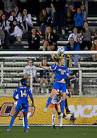 Sam Mewis, Morgan Stearns. UCLA advanced on penalty kicks after defeating Virginia, 1-1, in regulation time at the NCAA Women's College Cup semifinals at WakeMed Soccer Park in Cary, NC.