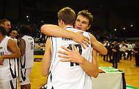 Tall Blacks captain Kirk Penney hugs Tom Abercrombie after the 100-78 win during the International basketball match between the NZ Tall Blacks and Australian Boomers at TSB Bank Arena, Wellington, New Zealand on 25 August 2009. Photo: Dave Lintott / lintottphoto.co.nz