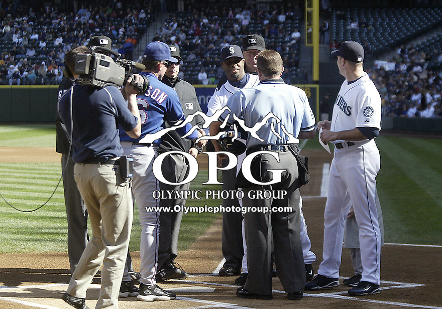 04 October 2009: Seattle Mariners Ken Griffey Jr and Mike Sweeney brought out the Mariners lineup cards for the umpire crew and Texas Rangers third base coach Dave Anderson. Seattle won 4-3 over the Texas Rangers at Safeco Field in Seattle, Washington.