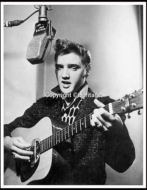 BNPS.co.uk (01202 558833)<br /> Pic: Heritage/BNPS<br /> <br /> ***Please Use Full Byline***<br /> <br /> A black and white photo of Elvis in the recording studio.<br /> <br /> The outfit Elvis Presley was wearing when he signed the momentous recording contract that rocketed him to international stardom has emerged for sale for 24,000 pounds.<br /> <br /> Despite being just 20 when he put pen to paper, Elvis was already the hottest thing in country music and was snapped up by record label giant RCA for a whopping 40,000 dollars - the equivalent of almost 400,000 dollars or 237,000 pounds today.