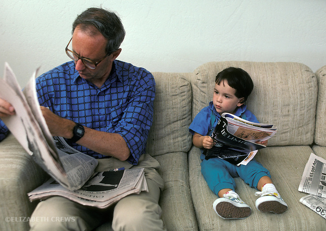 San Diego CA Boy, twenty-months-old modeling grandpa's reading of the paper   MR