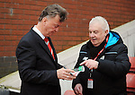 Manchester United Manager Louis van Gaal autograph's a programme for a fan<br /> - Barclays Premier League - Stoke City vs Manchester United - Britannia Stadium - Stoke on Trent - England - 26th December 2015 - Pic Robin Parker/Sportimage
