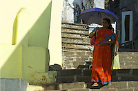 Mumbai, Banganga area women with colorful umbrella,India, a small Hindu area