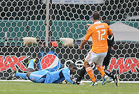 DC United goalkeeper Bill Hamid (28) dives to make a save.   Houston Dynamo tied DC United 2-2, at RFK Stadium, Saturday June 25, 2011.