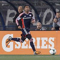 New England Revolution midfielder Lee Nguyen (24) looks to pass. In a Major League Soccer (MLS) match, the New England Revolution (blue) tied New York Red Bulls (white), 1-1, at Gillette Stadium on May 11, 2013.