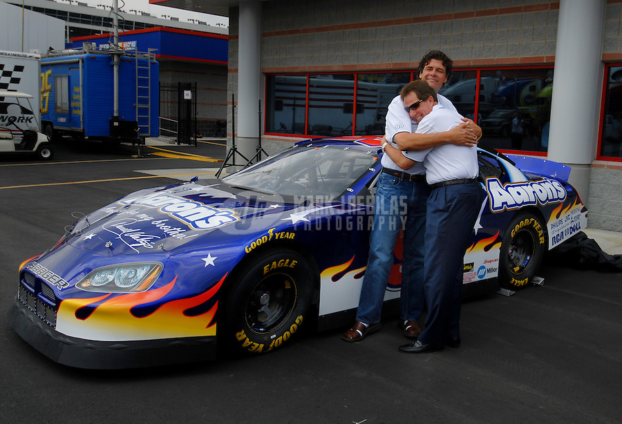 May 27, 2006; Charlotte, NC, USA; Nascar Nextel Cup driver Michael Waltrip poses with his brother Darrell Waltrip after announcing a one race deal for Darrell in Martinsville, VA later this year. Mandatory Credit: Mark J. Rebilas..