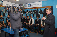 Bill Turnbull of BBC Breakfast gives Wycombe players a team talk during the Sky Bet League 2 match between Wycombe Wanderers and Exeter City at Adams Park, High Wycombe, England on 13 February 2016. Photo by Andy Rowland.