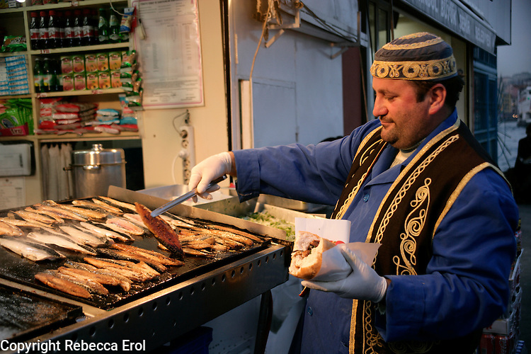 Serving a grilled fish sandwich by the quayside at Eminonu, Istanbul, Turkey