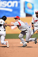 Carolina Mudcats third baseman Todd Hankins (8) tags out catcher Wynston Sawyer (18) during a game against the Frederick Keys on April 26, 2014 at Harry Grove Stadium in Frederick, Maryland.  Carolina defeated Frederick 4-2.  (Mike Janes/Four Seam Images)