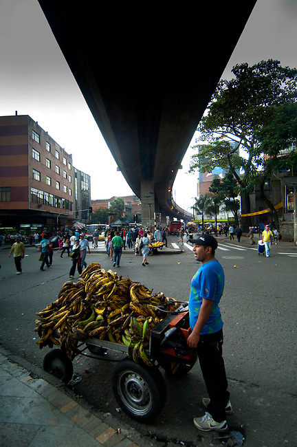 Street vendor selling plantains near Plaza Botero in Medellin.  Plaintain is a member of the banana family but is usually cooked before being eaten and is a dietary form of starch.