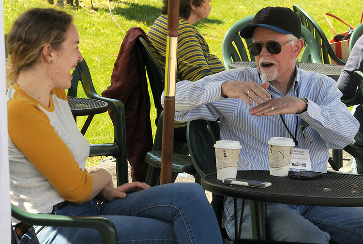 Former Market Manager, Ayla Rector, chats with, John Bassler, of the Market Committee, on duty at the Opening Day of the 2017 Saugerties Farmer's Market on Saturday, May 27, 2017. Photo by Jim Peppler. Copyright/Jim Peppler-2017.