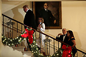 United States President Donald J. Trump, First Lady Melania Trump, US Vice President Mike Pence, and Karen Pence ascend the Grand Staircase in front of the portrait of US President Harry S. Truman after greeting guests at the Congressional Ball at White House in Washington on December 15, 2018. <br /> Credit: Yuri Gripas / Pool via CNP
