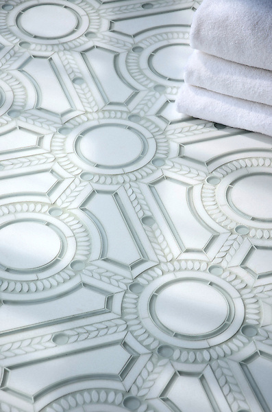 Augustus, a stone and glass waterjet mosaic, shown in honed Thassos, tumbled Thassos, and Tropical White Serenity glass, is part of the Parterre Collection by Paul Schatz for New Ravenna.