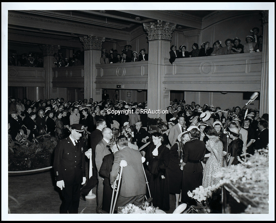BNPS.co.uk (01202 558833)<br /> Pic: RRAuction/BNPS<br /> <br /> March 17, 1952, Kennedy 'tea party,&rsquo; an image rarely ever seen, JFK stands in the receiving line as heleans on his crutches for support.<br /> <br /> Incredibly-rare photos highlighting the first foray into politics for John F. Kennedy that would eventually cost him his life have come to light.<br /> <br /> The 100 black and white snaps show a youthful-looking JFK from 1946, when he was campaigning to become a US congressman for the first time.<br /> <br /> The tragic future president is seen during an oration lesson where he was given help by an expert with public speaking and posture.<br /> <br /> The 29-year-old is also depicted mingling with the public at an annual parade and as well as celebrating his first political victory - a congressional primary vote - in June 1946.<br /> <br /> The images are being sold by US-based RR Auction.